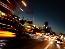 Гонки автомобилей часа пик для того чтобы получить дом стоковая фотография rf