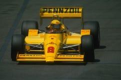 Гонки Рик Mears в его автомобиле Indy на следе Стоковые Фотографии RF