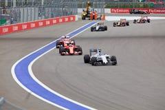 Гонки Valtteri Bottas Williams Мартини водят Kimi Raikkonen Scuderia Феррари Стоковая Фотография RF