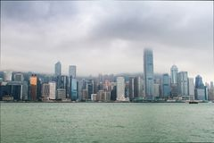 Гонконг, небоскребы, облака Стоковые Изображения