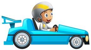 Гонщик в голубом гоночном автомобиле Стоковые Изображения