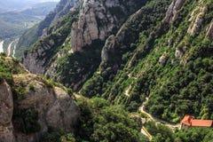 Гора Монтсеррата Каталонии, Испании Горы Монтсеррата и бенедиктинский монастырь Santa Maria de Монтсеррата Стоковое Фото