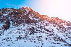 Гора снега на восходе солнца Стоковые Изображения
