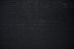 Горизонтальная часть черноты покрасила кирпичную стену, текстуру стоковое изображение