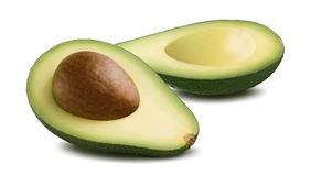 Горизонтальный авокадо отрезал половину изолированный на белой предпосылке Стоковое фото RF