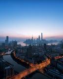 Горизонт города в заходе солнца Стоковое фото RF
