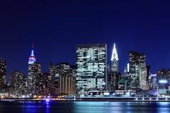 Горизонт Манхаттана на ноче, Нью-Йорк Стоковые Изображения