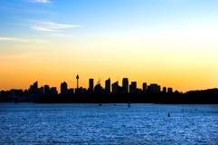 Горизонт Сиднея на заходе солнца Стоковое Фото