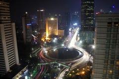 Горизонт Bundaran HI Джакарта ночи стоковое фото rf