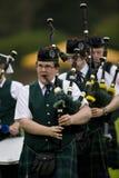 гористая местность Шотландия игр волынок Стоковые Изображения