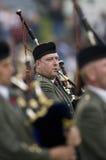 гористая местность Шотландия игр волынок Стоковые Изображения RF