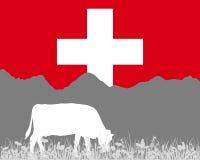 Горная вершина коровы и флаг швейцарца Стоковые Изображения RF