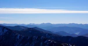 Горная цепь заволакивает панорамный ландшафт Стоковая Фотография RF