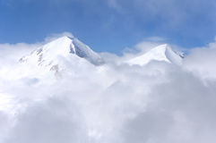 Горные пики зимы стоковые изображения