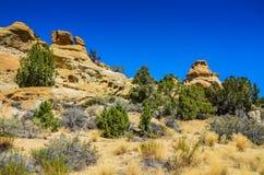 Горные породы песчаника - ацтек, NM Стоковое Изображение RF