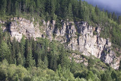 горный склон outcrops утесистое Стоковые Фото