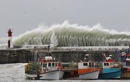 городок шторма плащи-накидк Стоковое Фото