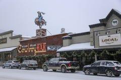 Городская Адвокатура ковбоя Jackson Hole Вайоминга во время шторма снега зи стоковые фотографии rf