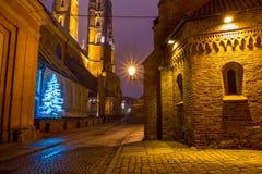 Городской пейзаж рождества - взгляд вечера собора St. John баптист, расположенного в районе Ostrow Tumski старом города Стоковое Изображение RF