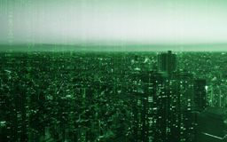 Город токио светлого здания с текстурой кодирвоания компьютера для технологии Стоковые Фотографии RF