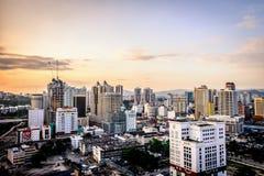 Город Куалаа-Лумпур на заходе солнца Стоковые Изображения