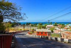 Городок рыбной ловли Oistins на южном береге Барбадос от обозревая холма Oistins Стоковое Изображение