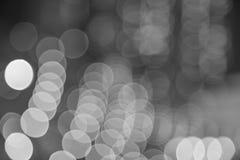 Город освещает предпосылку запачканную bokeh черно-белую Стоковое Фото