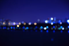 Город освещает предпосылку запачканную bokeh Стоковое Фото