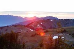 Горы и заход солнца Стоковые Изображения RF