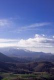 Горы и зеленые холмы в слоях Стоковая Фотография RF