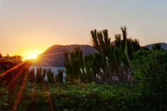 горы над заходом солнца Стоковые Фото