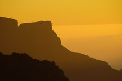 горы над заходом солнца Стоковое фото RF