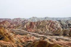 Горы радуги Danxia, провинция Zhangye, Ганьсу, Китай Стоковое Изображение
