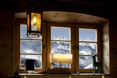 Горы через окно Стоковая Фотография