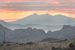 Горы Dell гранита восхода солнца, Prescott, Аризона США стоковые фотографии rf