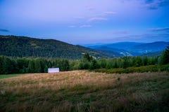 Горы Gorce на сумраке Стоковая Фотография