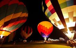 Горячая ноча зарева воздушных шаров Стоковое фото RF