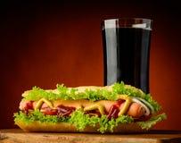 Горячая сосиска и кола Стоковая Фотография RF