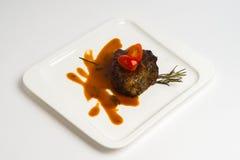 Горячее блюдо на белой предпосылке Стоковая Фотография