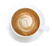Горячее взгляд сверху пены спирали кофе капучино изолированное на белом bac стоковое изображение