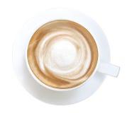 Горячее взгляд сверху пены спирали кофе капучино изолированное на белом bac стоковая фотография