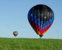Горячие воздушные шары в поле Стоковое фото RF