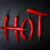 Горячие chilies на шифере Стоковые Изображения RF