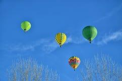 4 горячих воздушного шара в воздухе Стоковые Изображения