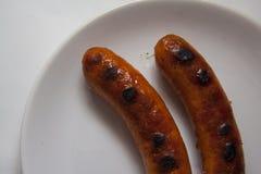 2 горячих сосиски на плите Стоковое фото RF