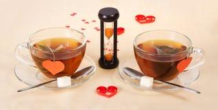 2 горячих чая и часа Стоковое Изображение