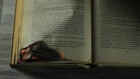 Горящая античная книга