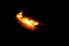 Горящие пламена на черной предпосылке Стоковое Изображение
