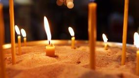 Горящие свечи в песке видеоматериал