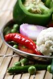горящие тучные овощи Стоковое Изображение